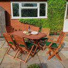 Rowlinson Plumley 7 Piece Hardwood Garden Furniture Set with Green Cushions